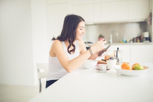 healthy woman eats breakfast
